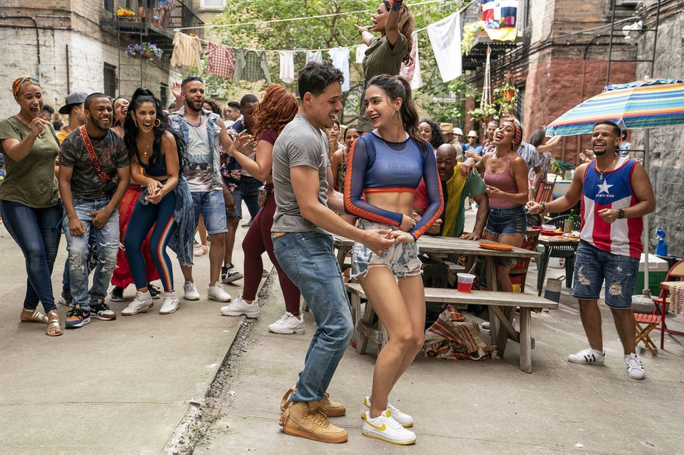 Anthony Ramos, left foreground, and Melissa Barrera in 'In the Heights. ' (Macall Polay/Warner Bros. Pictures)