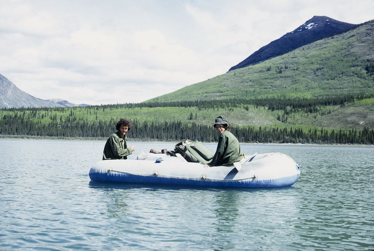 Jim Dore, left, and his younger brother Bob paddle their raft on the Yukon River between Dawson and Forty Mile in summer 1973. (Photo courtesy Jim Dore)