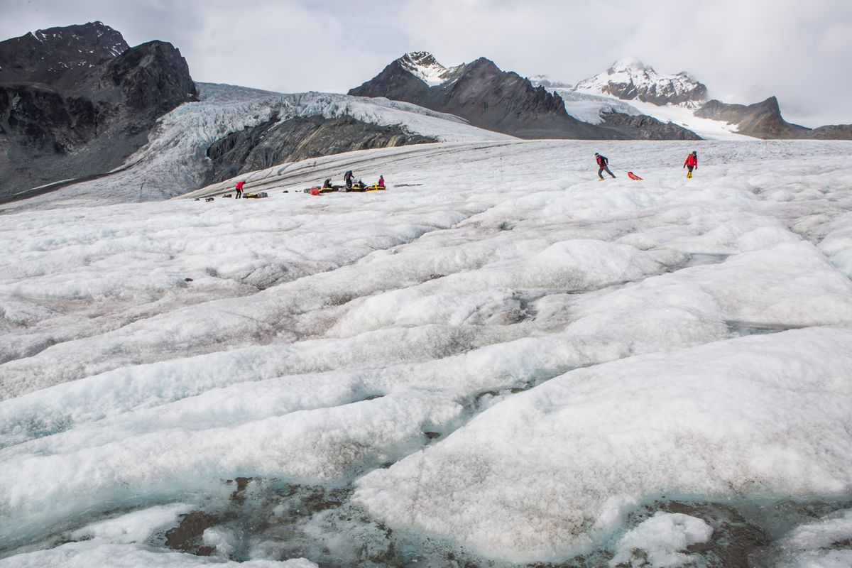 A collaborative team of scientists puts seismic equipment on Gulkana Glacier to see if a lander will work on icy Europa, one of Jupiter's moons. (Meghan Murphy)