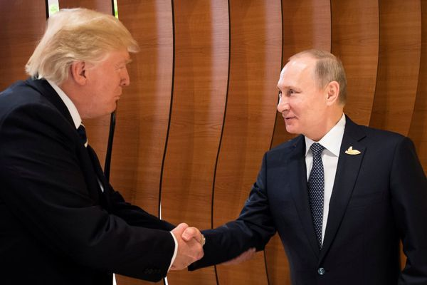 U.S. President Donald Trump and Russia's President Vladimir Putin shake hands during the G20 Summit in Hamburg, Germany in this still image taken from video, July 7, 2017. REUTERS/Steffen Kugler/Courtesy of Bundesregierung/Handout via REUTERS