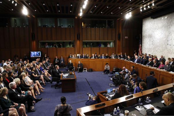 FILE - In this Sept. 4, 2018, file photo, Supreme Court nominee Brett Kavanaugh, left, attends his confirmation hearing with the Senate Judiciary Committee on Capitol Hill in Washington. (AP Photo/Jacquelyn Martin, File)