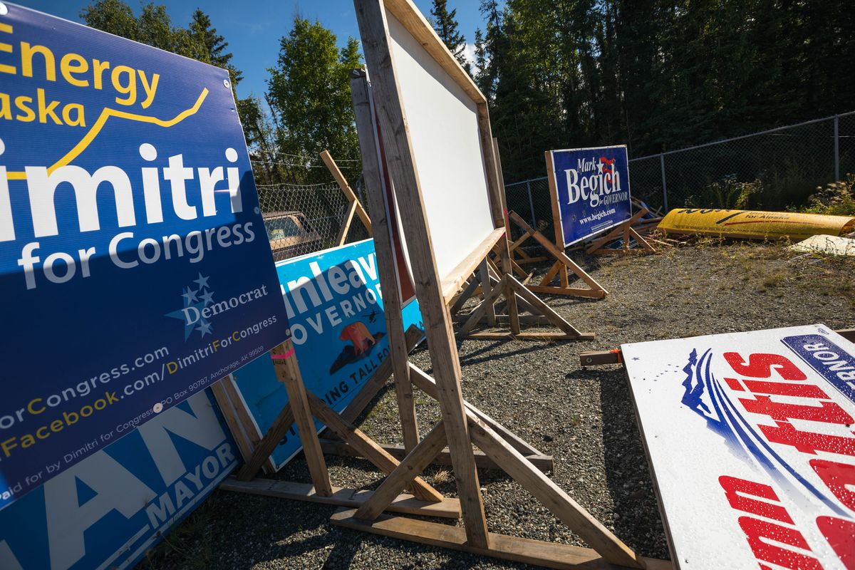 Political signs that were removed by the Alaska Department of Transportation sit in a DOT complex in Anchorage on Aug. 9. (Loren Holmes / ADN archive)