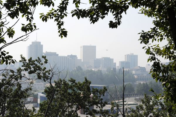 Smoke from the 92,657 acres, or about 144 square mile Swan Lake wildfire on the Kenai Peninsula has settled in Anchorage reducing the visibly and lowering the air quality to an