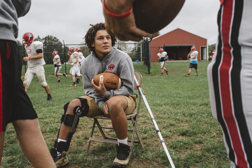 Quarterback Jace Humes, lost for the season to a knee injury, at a practice to support his teammates at Madison High School in Madison, Ind., Oct. 11, 2017. (Andrew Spear/The New York Times)