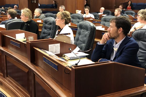 From right to left, Rep. Zack Fields, D-Anchorage; Rep. Colleen Sullivan-Leonard, R-Wasilla; and Rep. DeLena Johnson, R-Palmer, await the final results of a special session adjournment vote Thursday, June 13, 2019. (James Brooks / ADN)