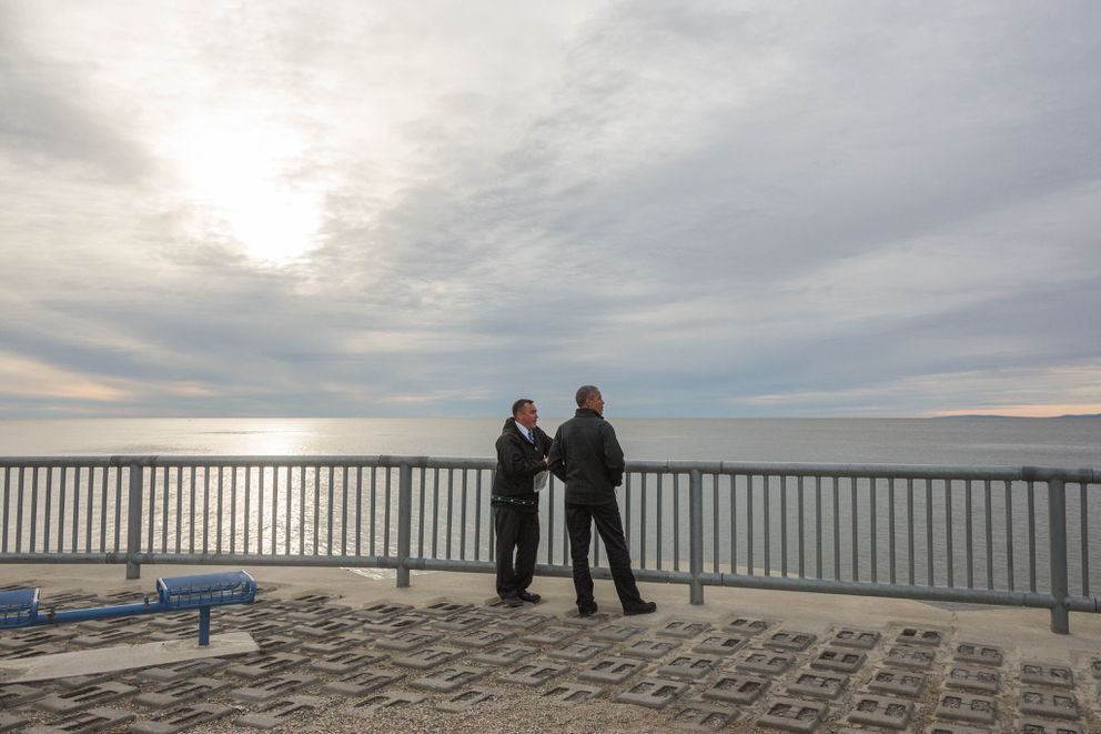 With Kotzebue City Manager Derek Martin, President Barack Obama, during his 2015 trip to Alaska, views the seawall that protects the community from winter storm surges. (Loren Holmes / ADN archive)