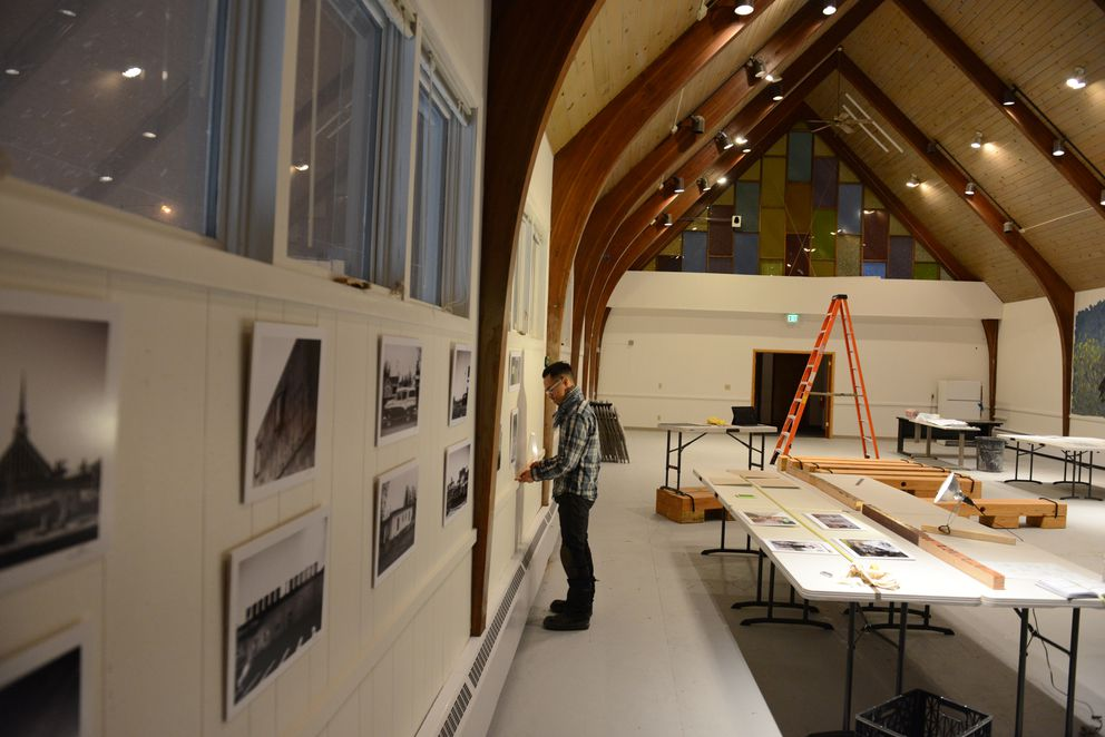 "Photographer Oscar Avellaneda-Cruz hangs the photography show ""Spenardia"" in the Church of Love on Spenard Road in Anchorage, Alaska on Friday, January 13, 2017. (Bob Hallinen / Alaska Dispatch News)"