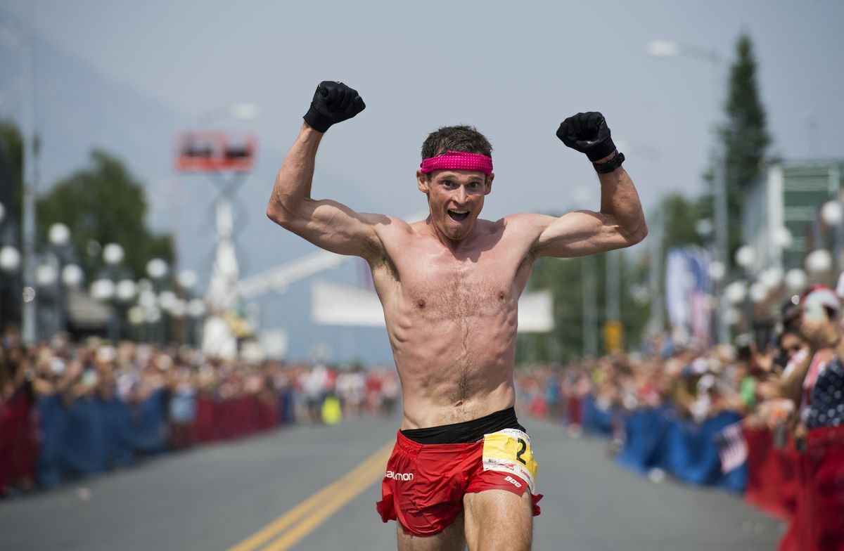 Max King, of Bend, Oregon, celebrates his win at the finish line in the Mount Marathon men's race Thursday in Seward. (Marc Lester / ADN)