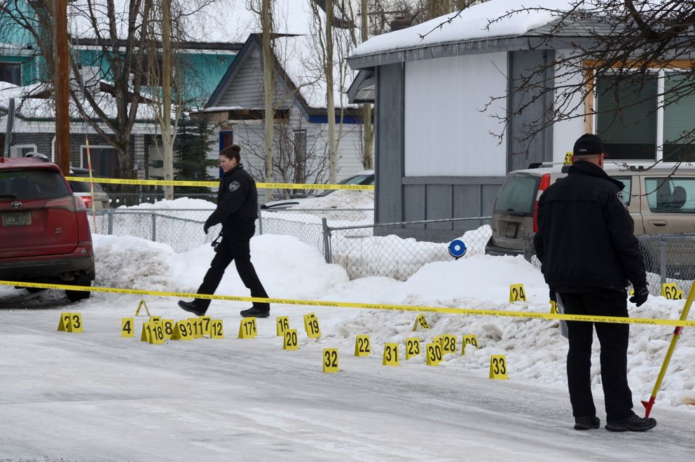 Anchorage police investigate an officer-involved shooting near 16th Avenue and Columbine Street in Airport Heights, Thursday, March 7, 2019. (Anne Raup / ADN)