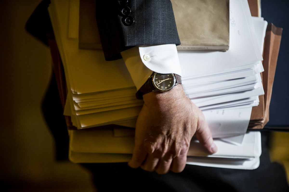 Multiple binders are carried on Capitol Hill on the evening Republicans advanced their tax legislation, in Washington, Dec. 1, 2017. (Justin Gilliland/The New York Times)