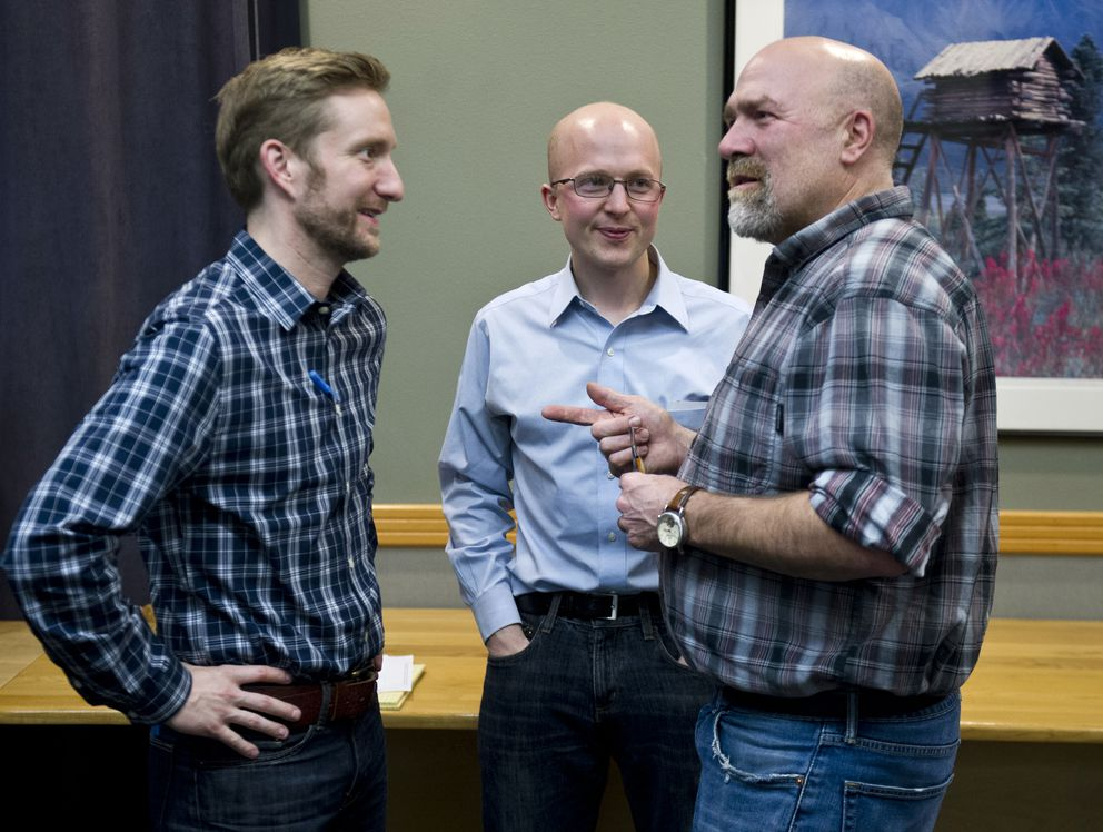 Rep.-elect Jason Grenn, of Anchorage, talks with Reps. Jonathan Kreiss-Tomkins of Sitka, center, and Adam Wool, of Fairbanks. Alaska House members announced a 22-member majority coalition made up of Democrats, Republicans and independents last Wednesday. (Marc Lester / Alaska Dispatch News)