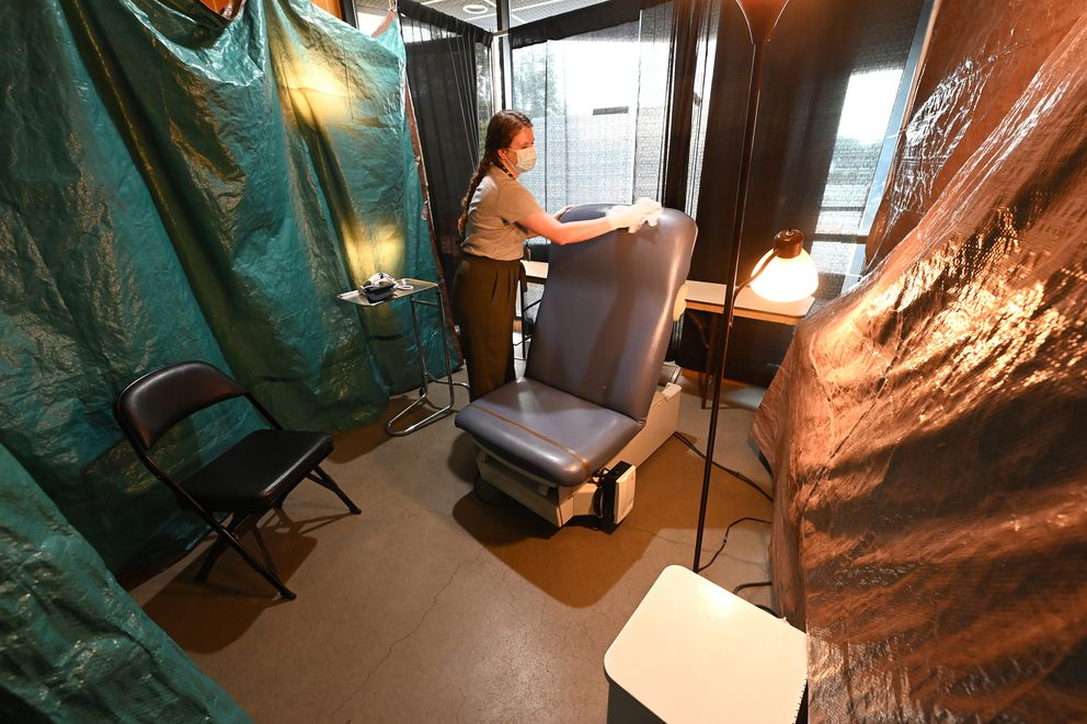 Third-year medical student Monica Ketchum prepares an exam room in the medical clinic in the Sullivan Arena shelter. (Bill Roth / ADN)