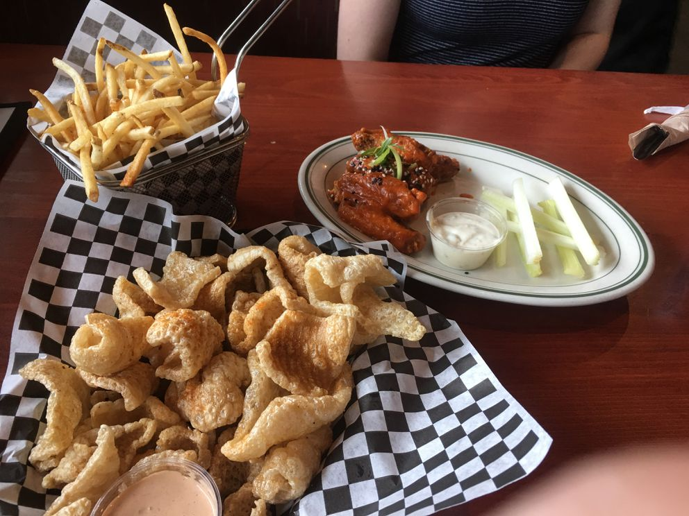 Appetizers at Table 6 in Midtown Anchorage: Chicharrons, wings and fries. (Photo by Mara Severin)