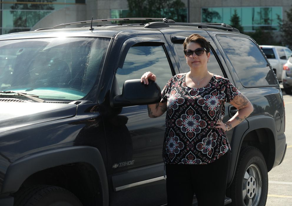 Sarah Pederson stands next to her 2002 Chevrolet Tahoe that was stolen twice. (Bob Hallinen / ADN)