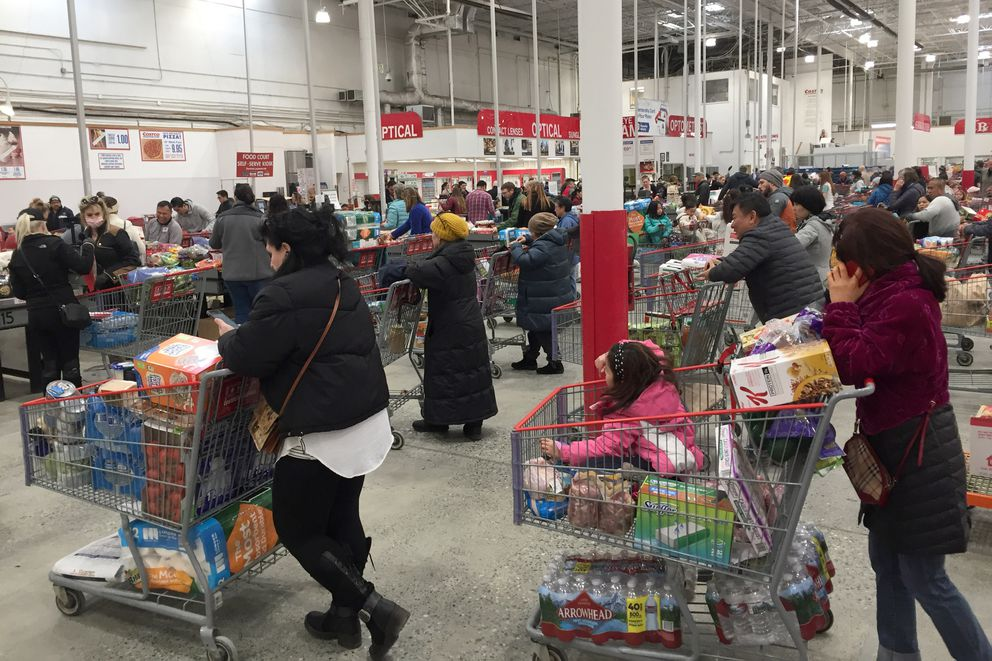 Checkout lines at Costco extended almost to the back of the store, Monday, March 16, 2020. (Alex DeMarban / ADN)