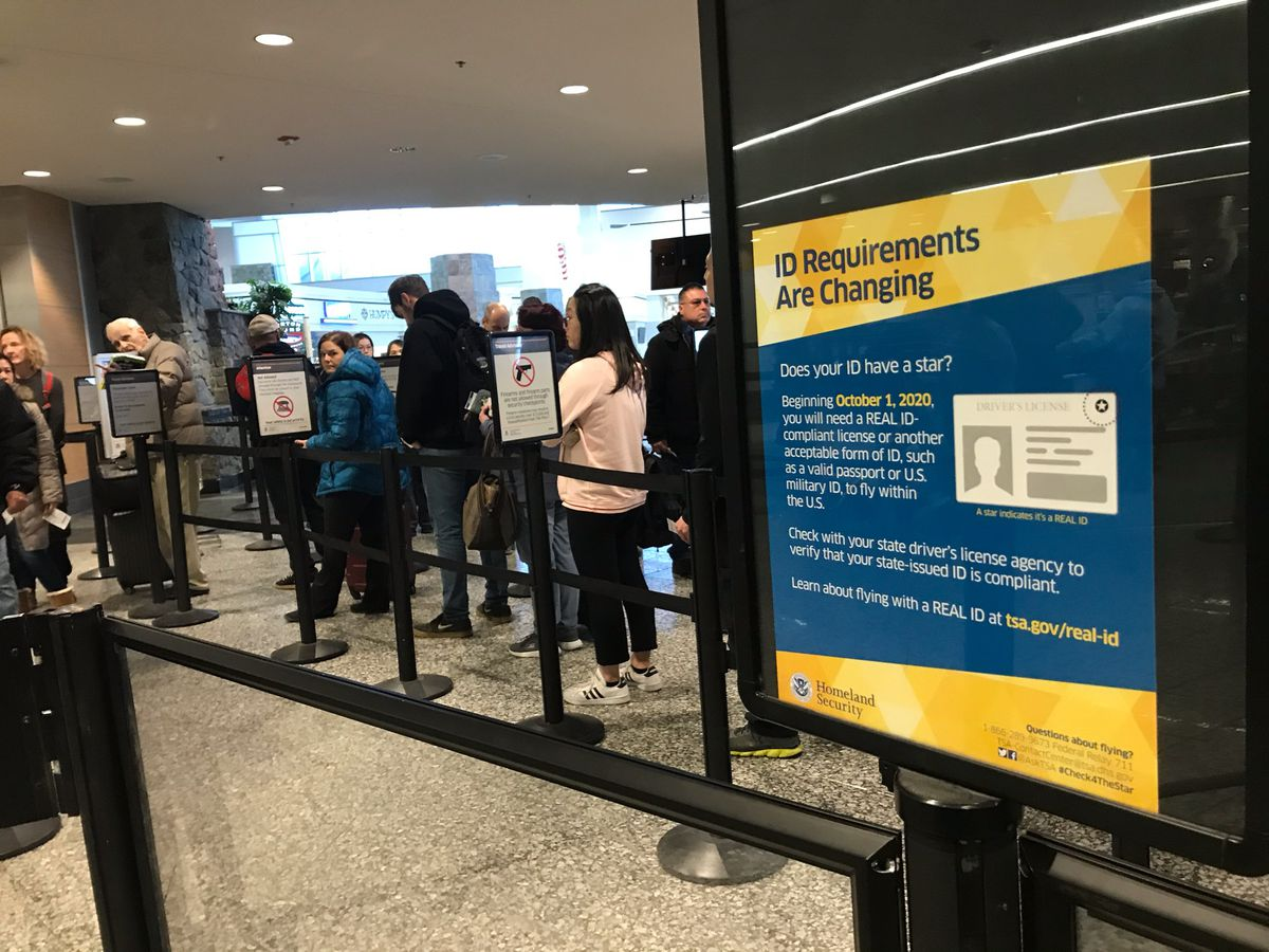 Passengers wait to go through a security checkpoint at the Ted Stevens Anchorage International Airport on Monday, Dec. 16, 2019. (Tess Williams / ADN)