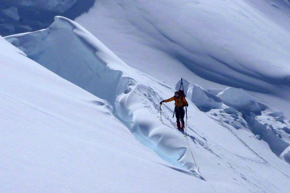 Connor Chilcott pauses at a crevasse at 12,000 feet. (Courtesy Forrest Barker)