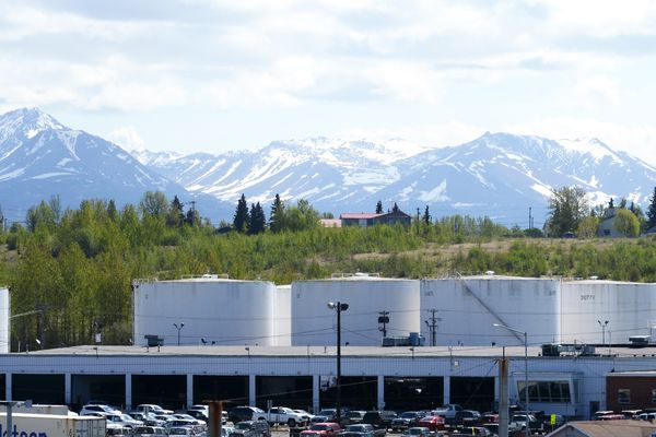 Fuel storage tanks sitting below the Government Hill neighborhood are viewed from the Port of Anchorage on Tuesday afternoon, May 23, 2017. (Erik Hill / Alaska Dispatch News)
