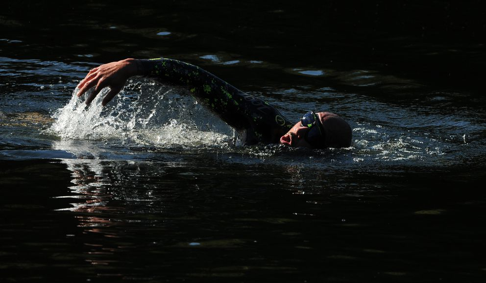 Justin Harris gets some swimming training in at Little Campbell Lake. (Bob Hallinen / ADN)