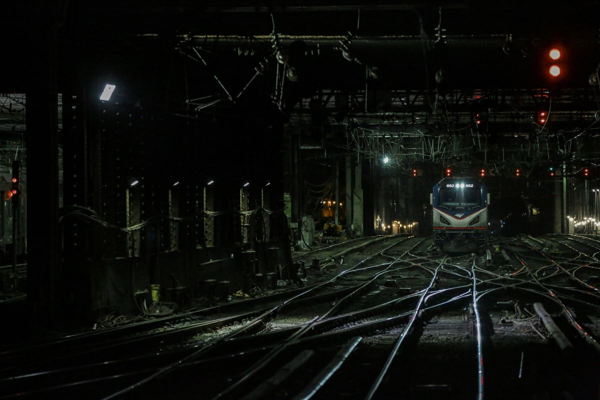An Amtrak train moves along the track at Penn Station in New York, U.S., on Friday, July, 7, 2017. Bloomberg photo by Jeenah Moon.