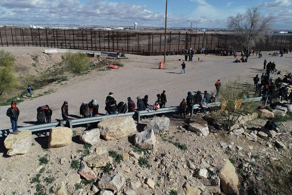 A group of approximately 150 migrants attempt to cross the Rio Bravo to reach the United States in Ciudad Juarez, Chihuahua, Mexico, on Dec. 18. (Tribune Content Agency)