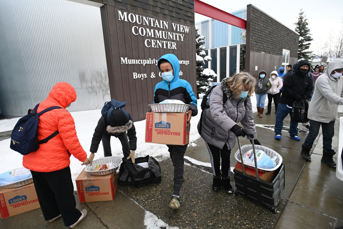People received all the fixings needed to make a holiday meal, including a frozen turkey, during the annual Thanksgiving Blessing food distribution at the Mountain View Community Center Boys and Girls Club on Monday, Nov. 23, 2020. (Bill Roth / ADN)