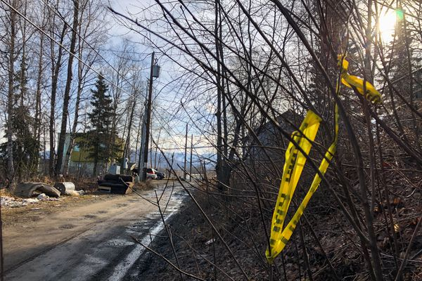 Crime scene tape surrounds the site of a homicide in East Anchorage on Tuesday morning, April 9, 2019. (Loren Holmes / ADN)