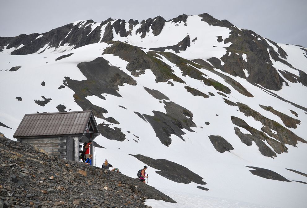 Hikers gather at the emergency shelter located near the end of the Harding Icefield Trail on Saturday, July 2, 2016. (Vicky Ho / Alaska Dispatch News)