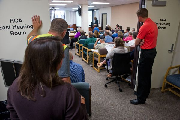 OPINION: House candidate Laurie Hummel argues that the Regulatory Commission of Alaska added insult to injury in keeping public out of Enstar rate hike. Pictured: An overflow crowd at the last week's after-the-fact hearing on the RCA decision.