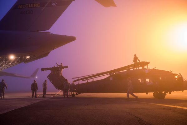 Guardsmen load a HH-60 Pave Hawk helicopter into a C-17 transport plane Tuesday, Sept. 26, 2017 at Joint Base Elmendorf-Richardson. The 210th Rescue Squadron, part of the Alaska Air National Guard 176th wing, is deploying to the Middle East on a combat search and rescue mission. (Loren Holmes / Alaska Dispatch News)