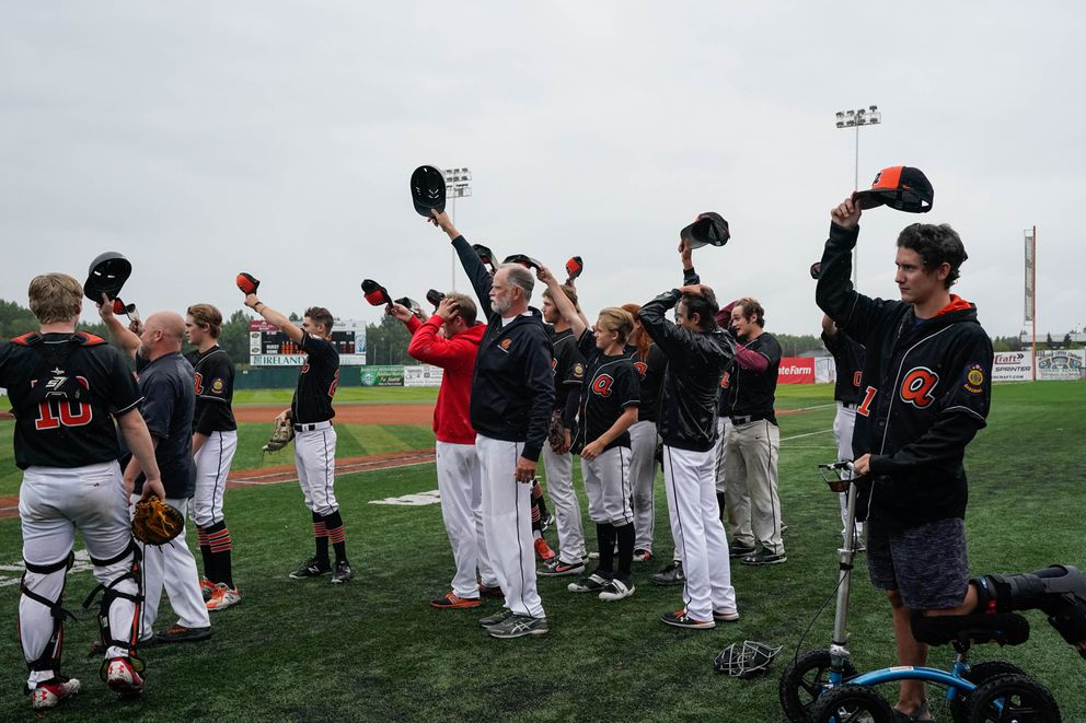The West Eagles tip their hats toward the Juneau Midnight Suns after their 3-0 win. The hat tip replaces the traditional post-game handshake, which isn't happening because of the COVID-19 pandemic. (Loren Holmes / ADN)