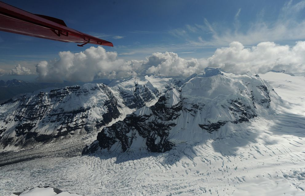 The Tokositna Glacier is visible as Talkeetna Air Taxi pilot Kris Peterson flies a Beaver airplane on a flightseeing tour of Denali and the peaks and glaciers on the south side of the mountain on Tuesday, July 21, 2015. Talkeetna Air Taxi is based out of Talkeetna, and flies tours of the mountain in Denali National Park. (Bob Hallinen / ADN archive)