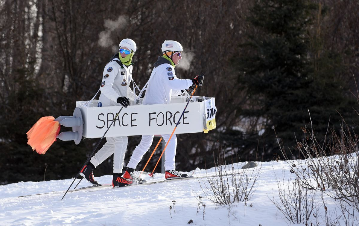 Service's Hayden Ulbrich, left, and Matthew Terry ski together as members of the Space Force. (Matt Tunseth / ADN)