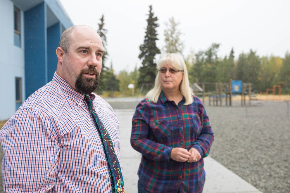 Butte Elementary principal Joshua Rockey and Butte resident Sally Beach, photographed at the school on Wednesday, Aug. 15, 2019. Beach is part of an effort to install new playground equipment in memory of five girls who were killed in a mobile home fire in 2017. (Loren Holmes / ADN)