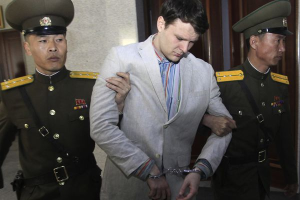 FILE - In this March 16, 2016, file photo, American student Otto Warmbier, center, is escorted at the Supreme Court in Pyongyang, North Korea. North Korea reportedly insisted the U.S. pay $2 million in medical costs in 2017 before it released dWarmbier while he was in a coma. (AP Photo/Jon Chol Jin, File)
