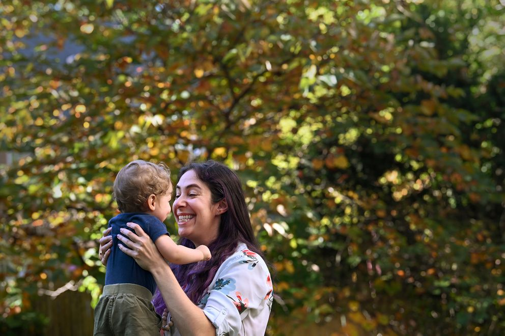 Danielle Lafave plays with her son at their home in Washington, D.C. She decided to quit her job in March. 'We can afford it for a year if we need to, and then we'll re-evaluate, ' she says. (Washington Post photo by Katherine Frey)