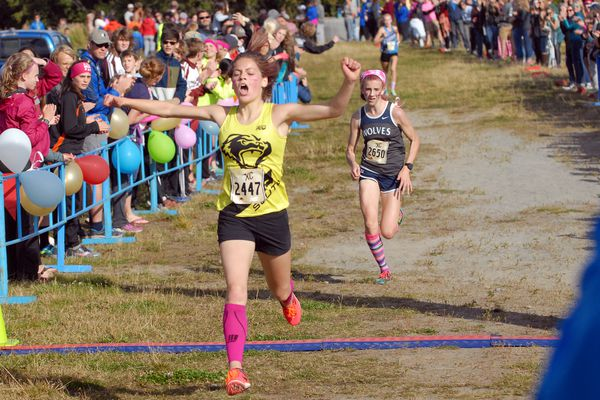 South's Ava Earl crosses the finish line after winning the girls varsity race at the Big 8 XC Classic cross country races on Saturday, Sept. 15, 2018 at Kincaid Park. (Matt Tunseth/ADN)