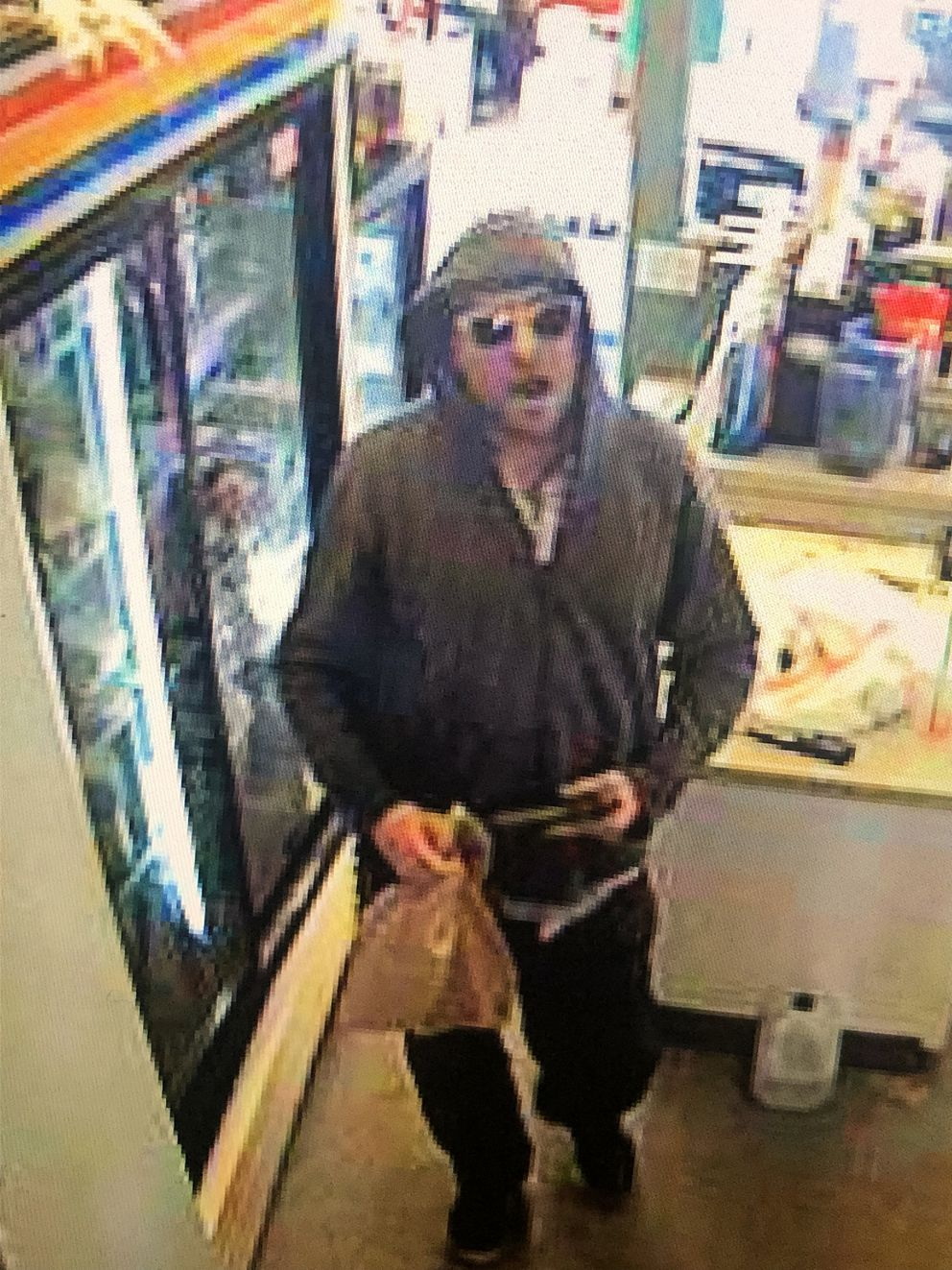 Police released this photo of a suspect in the robbery of Perkup Espresso, a coffee stand on Potter Drive, on Thursday afternoon. (Courtesy APD)