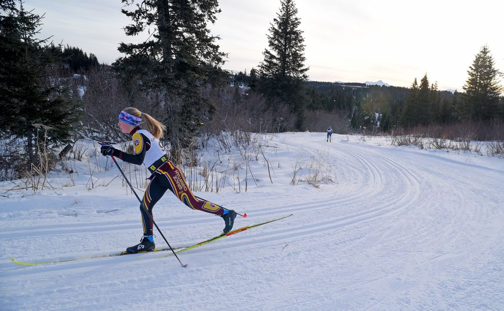 Elise Metzger works her way through the girls 5K race. (Photo by Eric Engman)