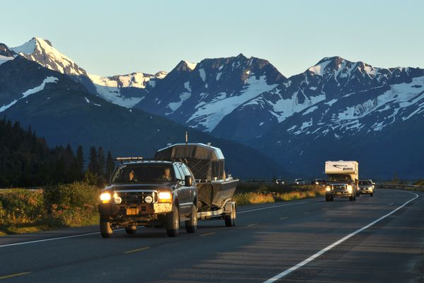 Traffic heads towards along the Seward Highway near the Twenty Mile River at sunset on Friday September 10, 2010 with the Kenai Mountains in the background. (BOB HALLINEN / ADN archive 2010)