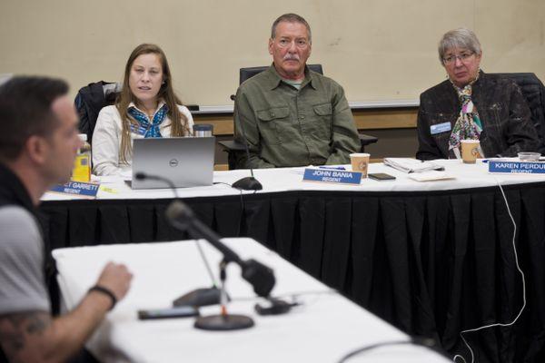 University of Alaska Board of Regents members Cachet Garrett, John Bania and Karen Perdue listen to comment from UAA women's basketball coach Ryan McCarthy on September 12, 2019. (Marc Lester / ADN)