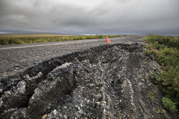 The melting permafrost is undermining and ruining roads throughout the once year-round frozen areas of Alaska. This is on Nome-Teller road near the village of Teller. Photographed Friday, August 23, 2019. (Steve Ringman / The Seattle Times)