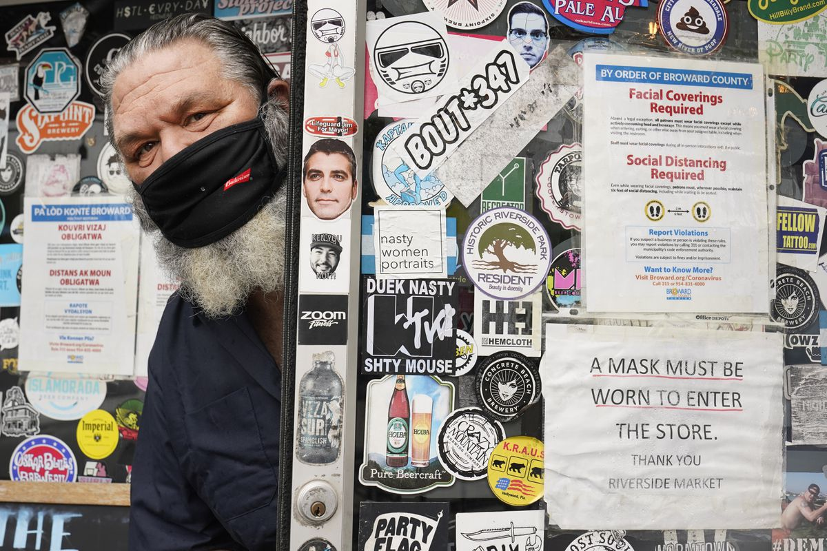 Julian Siegel, owner of The Riverside Market, poses for a photo, Monday, Sept. 21, 2020, in Fort Lauderdale, Fla. Siegel figures business dropped about 20% earlier this spring at his, restaurant after someone posted a picture on the Nextdoor app of people waiting in his parking lot for food. (AP Photo/Wilfredo Lee)