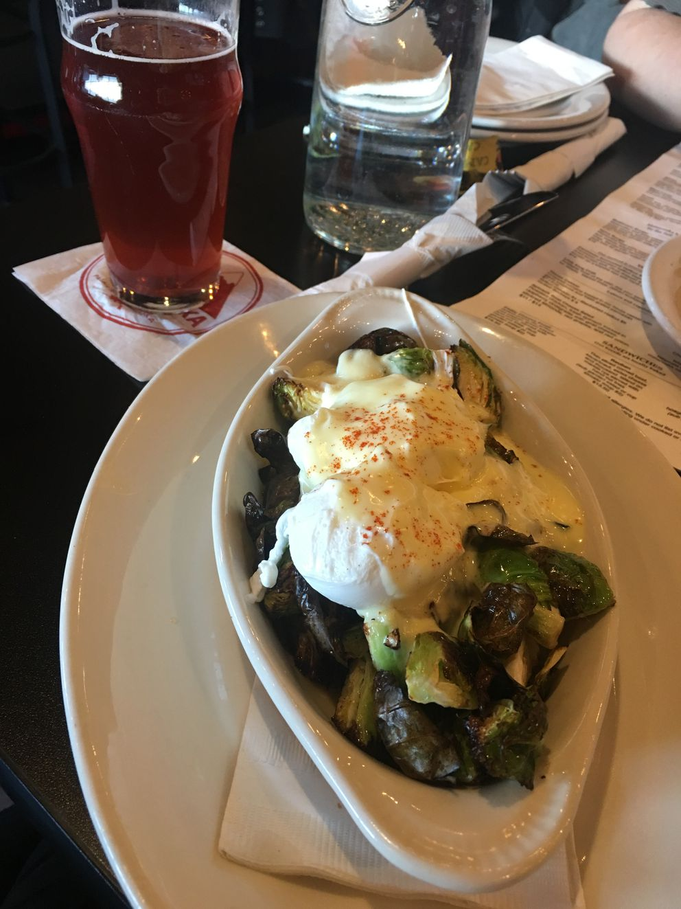 Roasted Brussels sprouts ($10) with a poached egg and hollandaise at Matanuska Brewing Company Anchorage (Photo by Mara Severin)