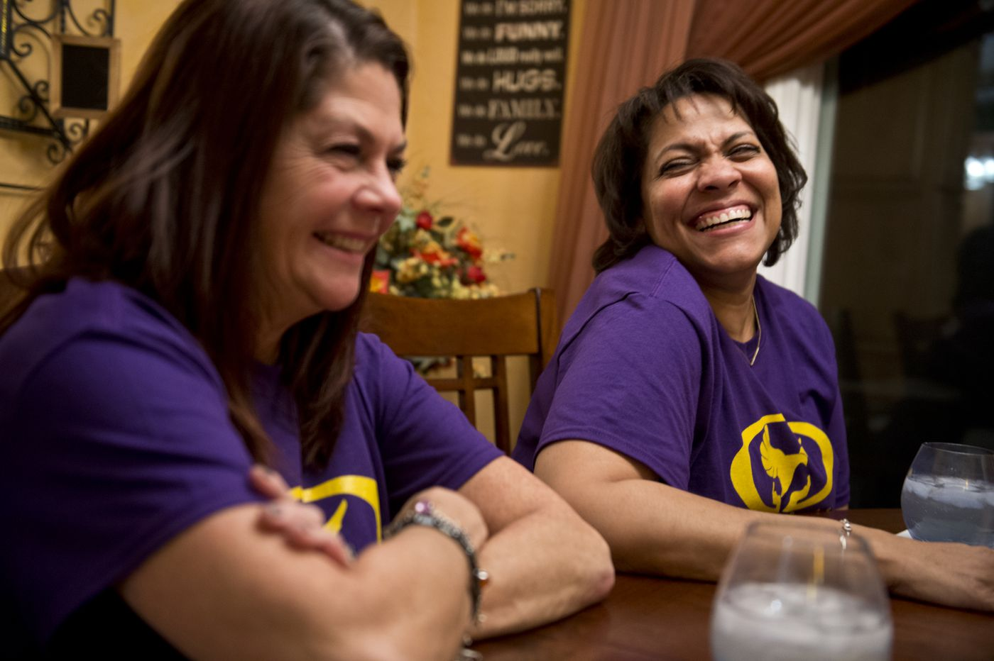 Jaimie Farrell, left, and Michele McKean talk at a dinner party McKean hosted on Dec. 1 for friends who attended the Route 91 Harvest Festival months earlier. (Marc Lester / ADN)