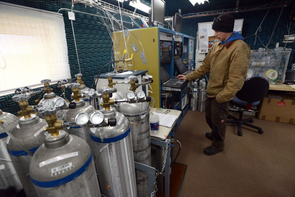 Technician Ross Burgener checks data collection as he staffs the NOAA Global Monitoring Division Barrow Observatory on September 21, 2015. Calibration tanks at left contain specific amounts of oxygen and other gases to verify the accuracy of analyzers on site. Air samples are collected, moisture is removed, and analyzers measure levels of methane, carbon dioxide, aerosols and other gases to add readings to an ongoing database begun in 1973. (Erik Hill / Alaska Dispatch News)