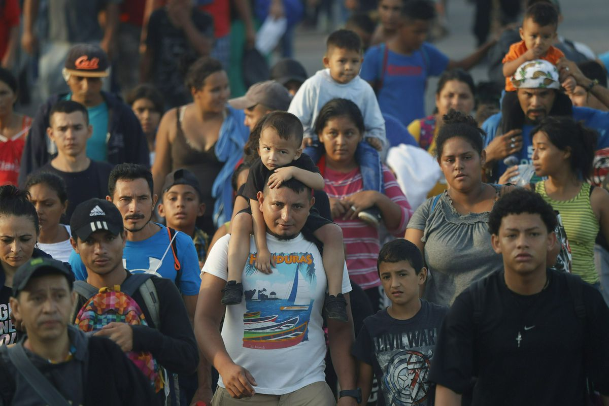 Hundreds of Central American migrants walk together on the highway, after crossing the Guatemala – Mexico border, near Ciudad Hidalgo, Mexico, Wednesday, June 5, 2019. State and local police provided a security escort to the migrants as they walked along a highway leading from the border to the first major city in Mexico, Tapachula. (AP Photo/Marco Ugarte)