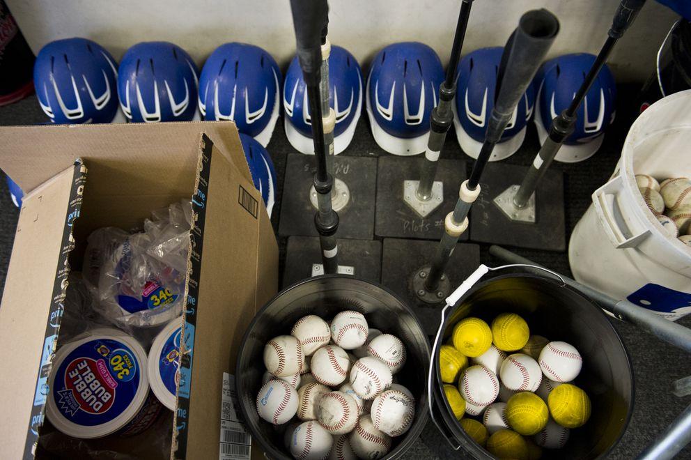 Helmets, baseballs and bubble gum await the arrival of the Alaska Baseball League season inside the Anchorage Glacier Pilots clubhouse on June 4, 2018. (Marc Lester / ADN)