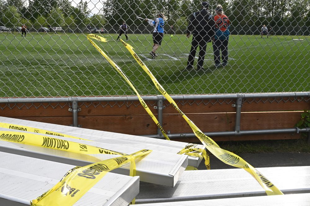 Bleachers are off limits for spectators as adult softball leagues resumed play at Cartee Fields in Anchorage on Tuesday, June 2, 2020. (Bill Roth / ADN)