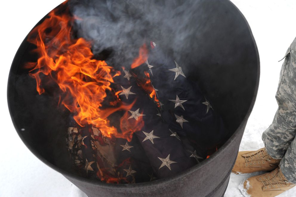 Flags that were no longer fit to be displayed were properly disposed of by burning during the flag retirement ceremony. (Bill Roth / ADN)